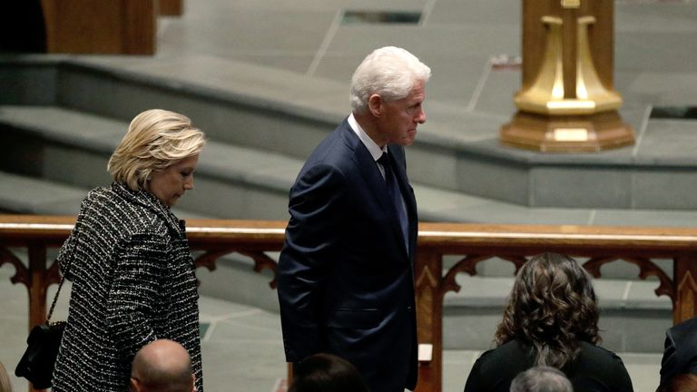 Accompanied by his wife, Hillary Clinton,left, former President Bill Clinton arrives at St. Martin's Episcopal Church for a funeral service for former first lady Barbara Bush, Saturday, April 21, 2018, in Houston. (AP Photo/David J. Phillip )