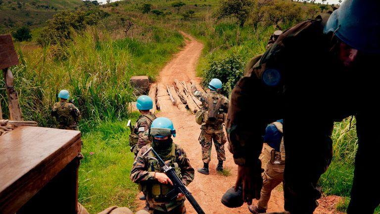 UN peacekeeping soldiers return to their patrol vehicle in the Djugu area of Iuri
