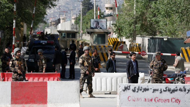 Security forces stand guard at the site of the blast