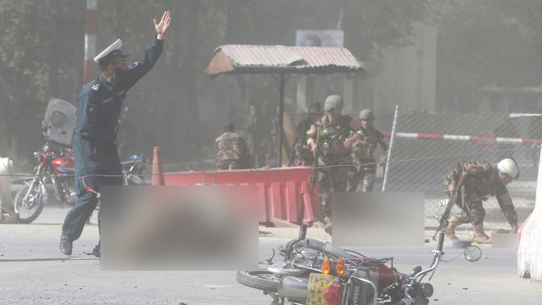 Afghan security forces at the site of a second blast in Kabul