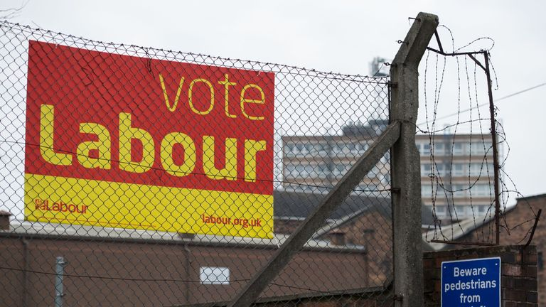 An election campaign poster for the Labour Party is seen in Stoke-on-Trent, central England on February 14, 2017.