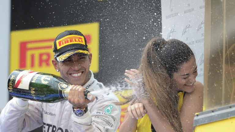 Lewis Hamilton sprays champagne over a grid girl after the Spanish grand prix in 2014