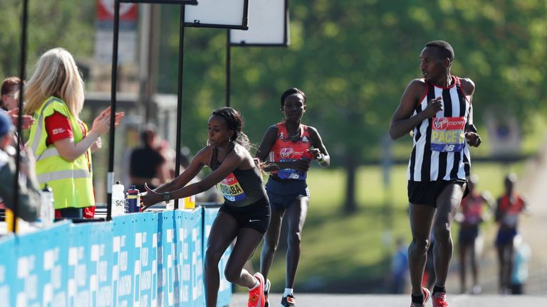 Ethiopa's Tirunesh Dibaba takes a drink during the women's elite race