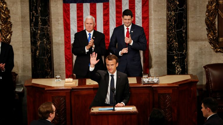 French President Emmanuel Macron acknowledges applause after addressing a joint meeting of Congress in the House chamber of the U.S. Capitol in Washington, U.S., April 25, 2018. REUTERS/Aaron Bernstein