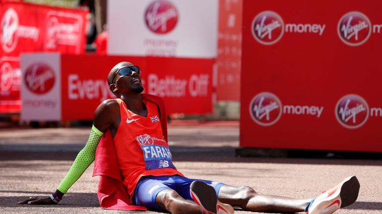 Mo Farah falls to the floor after finishing third
