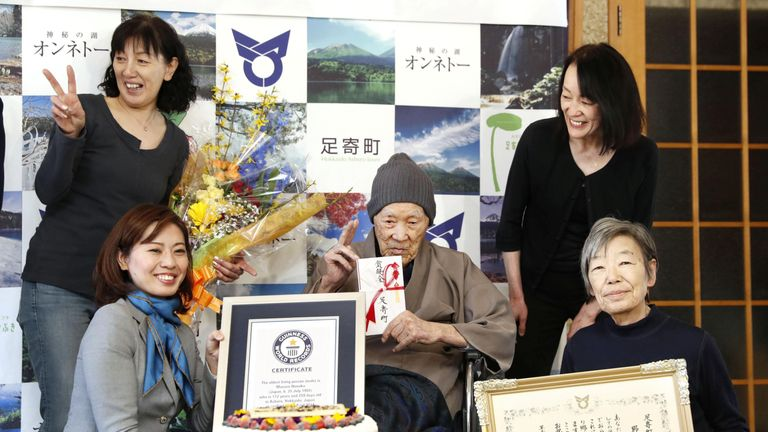 Masazo  with his family as he receives the Guinness World Records certificate