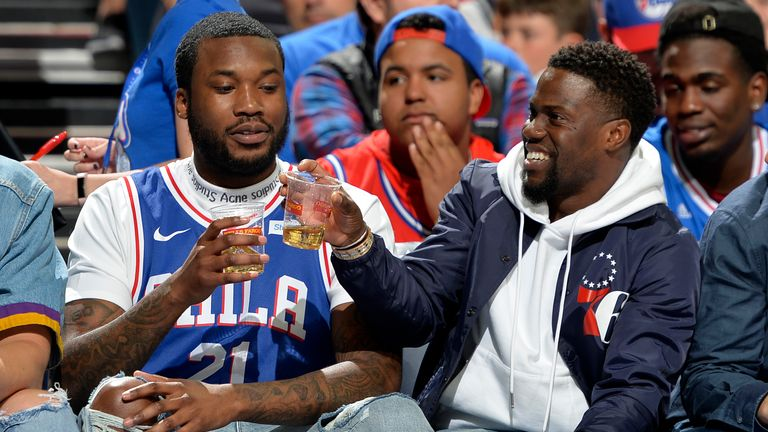 Mill and Hart celebrate with a drink courtside at the game