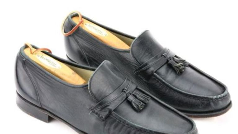 "These black leather Florsheim Imperial loafers are the shoes that Michael Jackson wore during the rehearsal of ""Billie Jean"", a rehearsal which marks the very first time Michael Jackson ever performed his now famous moonwalk on stage. Being auctioned in May. Pic: GWS Auctions, Inc"