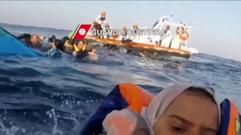 Migrants rescued by Italian coastguard after boat capsizes