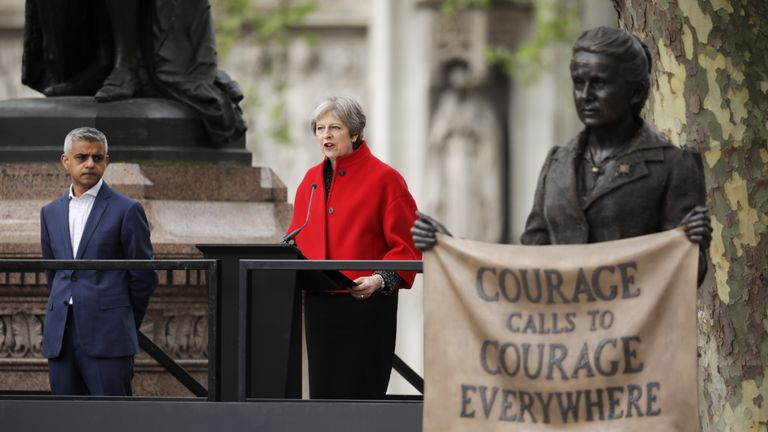 Theresa May gives a speech as Sadiq Khan looks on during the official unveiling of a statue in honour of the first female Suffragette Millicent Fawcett