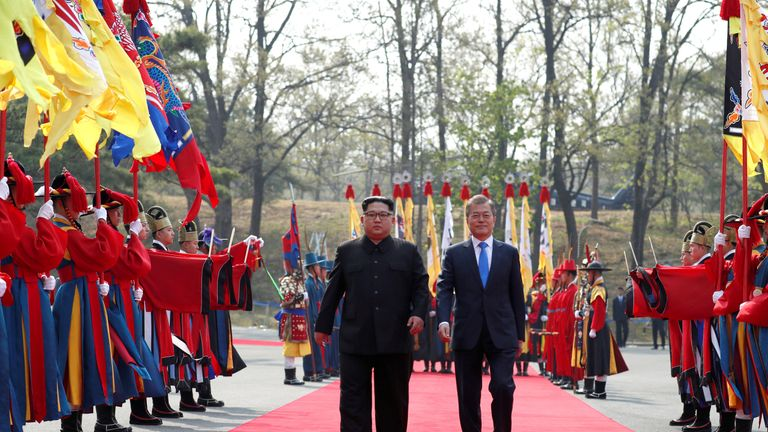 South Korean President Moon Jae-in walks with North Korean leader Kim Jong Un at the truce village of Panmunjom