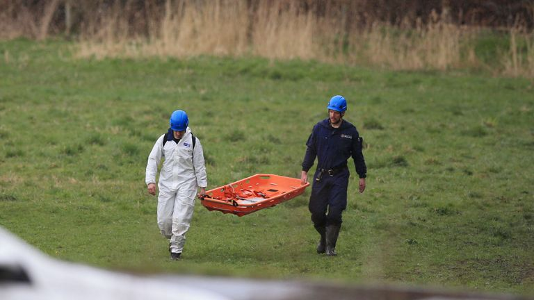 Police carry away evidence after the newborn girl was found