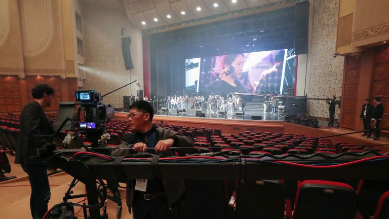 South Korean video crew check a rehearsal of a concert by South Korean musicians at the 1,500-seat East Pyongyang Grand Theatre in Pyongyang on April 1, 2018. Top South Korean musical acts including a K-pop girlband are set to hold a rare concert in North Korea on April 1 evening in a latest reconciliatory gesture ahead of a historic inter-Korea summit. / AFP PHOTO / KOREA POOL / KOREA POOL / South Korea OUT (Photo credit should read KOREA POOL/AFP/Getty Images)