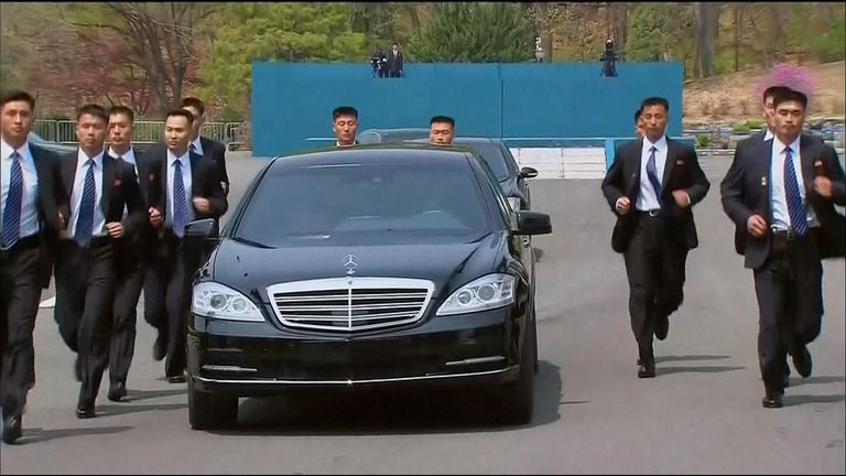 Security personnel jogged alongside Mr Kim's car as he went for lunch