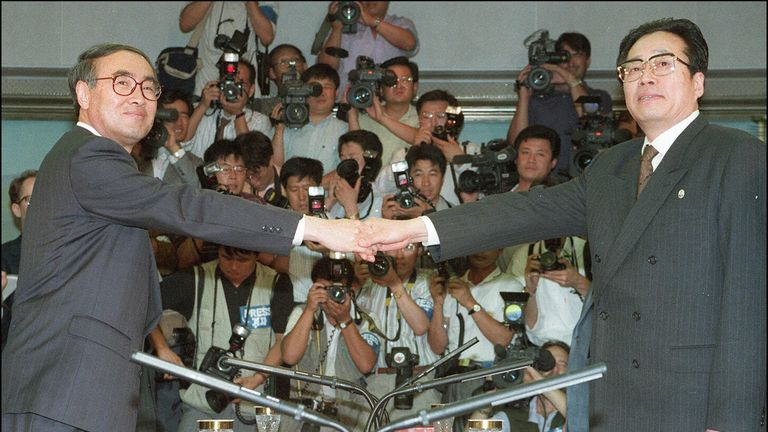 South Korean deputy prime minister Lee Hong-Koo (L) shakes hands with Kim Yong-Sun, N Korean chair of the reunification policy in 1994