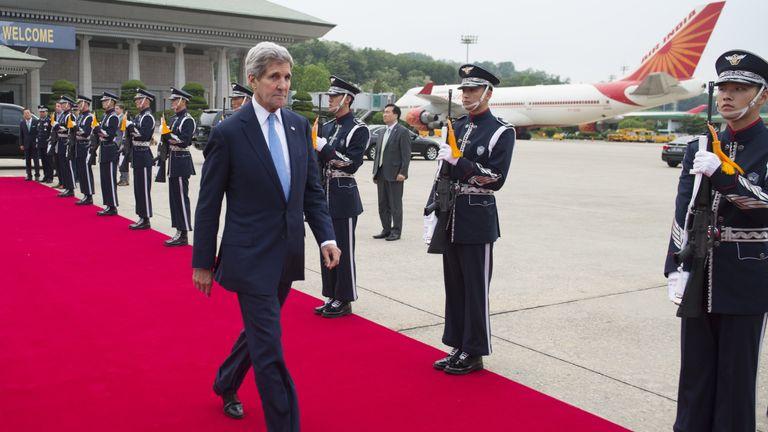 Former US Secretary of State John Kerry boards a plane in Seoul in 2015 after slamming Kim Jong Un's 'egregious' leadership