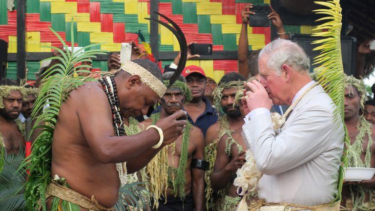 Prince Charles drinks kava with Chief Seni Mao Tirsupe, the President of the Malvatumauri Council of Chiefs, to the Chiefs Nakamal in Port Vila, Vanuatu