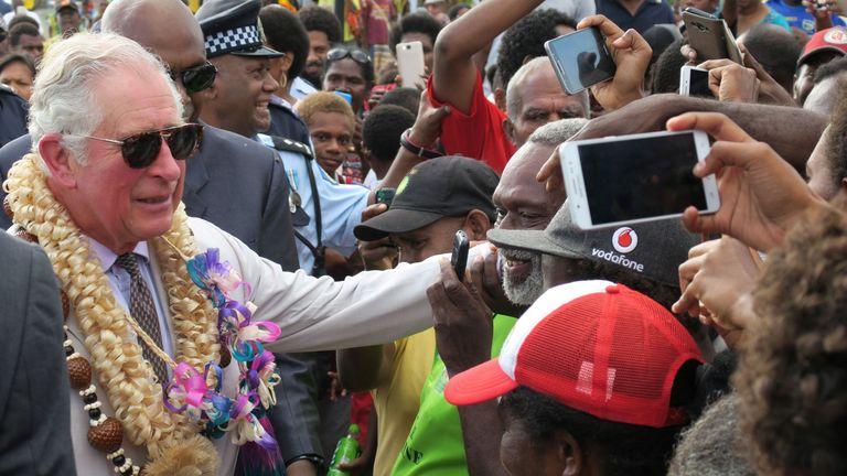 Prince Charles greets well-wishers as he walks along the seafront in Port Vila, Vanuatu, on April 7 2018