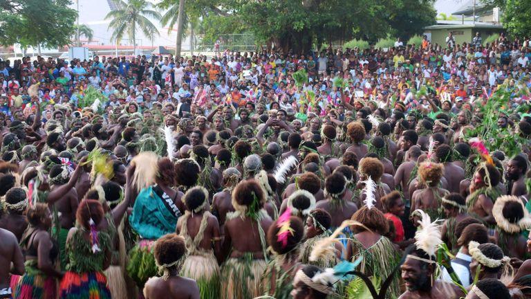 Vanuatu residents perform the 'kastom' dance for Prince Charles during his visit to Port Vila on April 7, 2018
