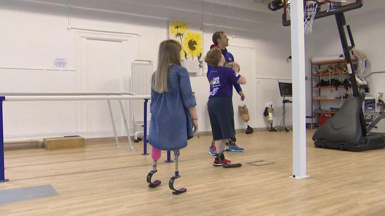 Ollie practices his basketball with his prosthetics
