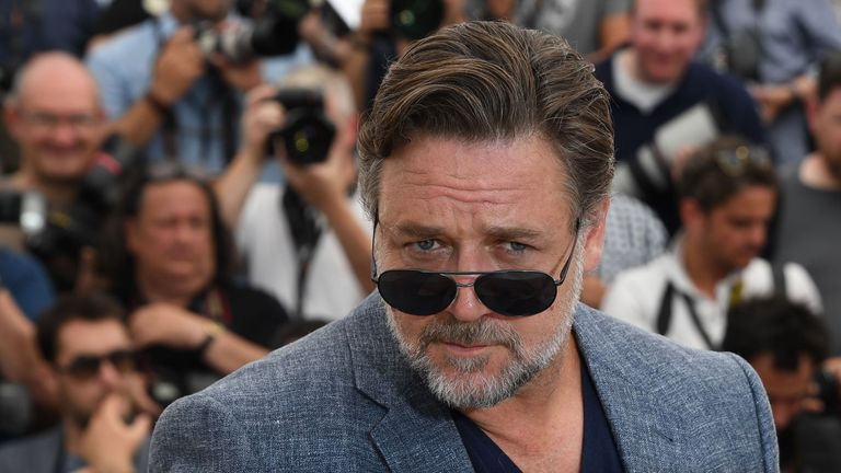 New Zealander actor Russell Crowe poses on May 15, 2016 during a photocall for the film 'The Nice Guys' at the 69th Cannes Film Festival in Cannes, southern France. / AFP PHOTO / ANNE-CHRISTINE POUJOULAT (Photo credit should read ANNE-CHRISTINE POUJOULAT/AFP/Getty Images)