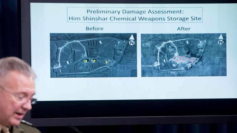 Director, Joint Staff, US Marine Lt. Gen. Kenneth F. McKenzie Jr., shows a damage assesment image of the Him Shinshar Chemical Weapons Storage site as he briefs the press on the stikes against Syria, at the Pentagon in Washington, DC, on April 14. 2018