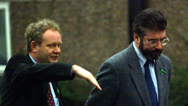 Sinn Fein President Gerry Adams (R) and Martin McGuinness take a break from the Northern Ireland talks, as former US Senator George Mitchell's review of the Good Friday Agreement at Castle Buildings, Belfast, continues.