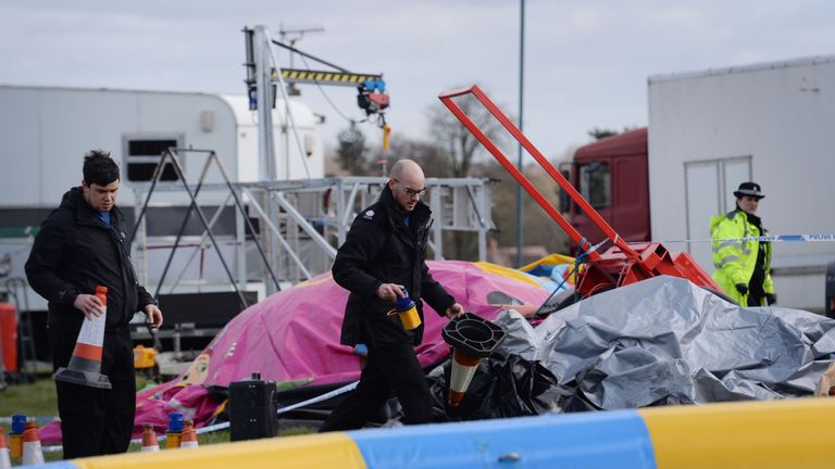 Police and forensic officers at the scene where seven-year-old Summer died