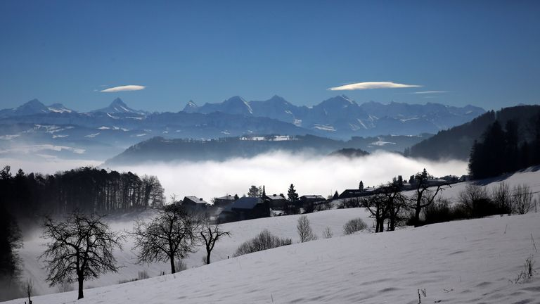 The Alps are seen behind fog near Bern, Switzerland March 4, 2018. REUTERS/Stefan Wermuth