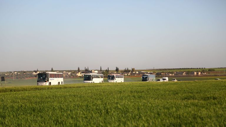Buses carrying Jaish al Islam fighters from Douma arrive in the town of Azaz