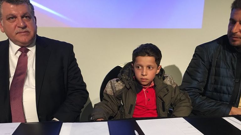 A young Syrian boy, one of a group of several Syrians bought to the OPCW briefing