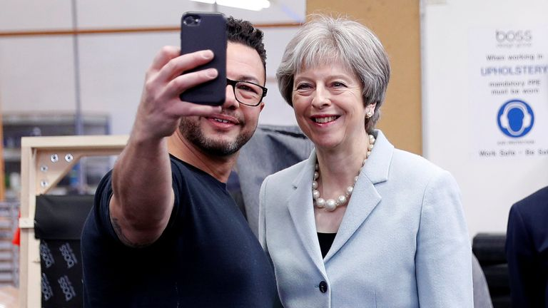 Theresa May poses for a selfie with upholsterer Derek Whitehouse during a campaign visit to Dudley