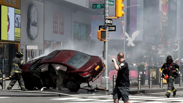 A vehicle that struck pedestrians and later crashed is seen on the sidewalk in Times Square in New York City