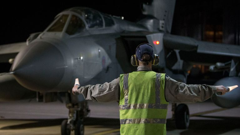 An RAF Tornado taxis into its hangar at RAF Akrotiri after conducting airstrikes