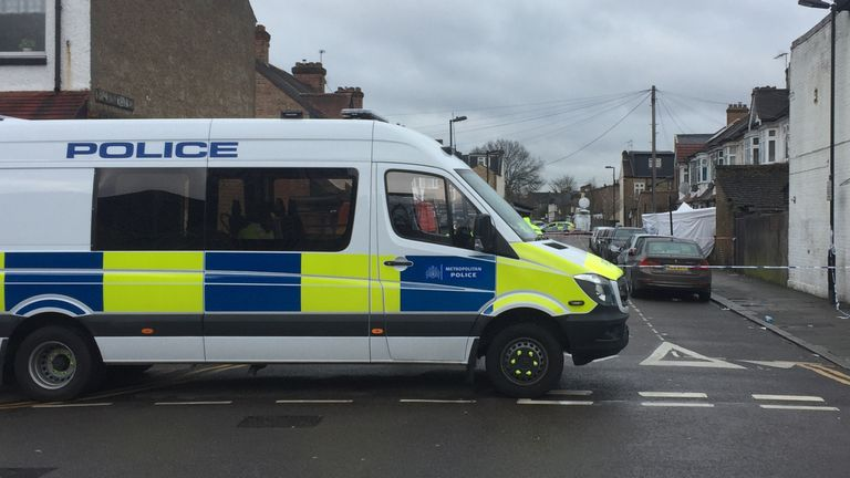 A police van outside Chalgrove Road, where the teenager was found