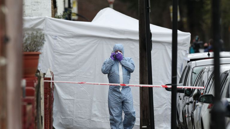 A forensic officer on Chalgrove Road, where the victim died