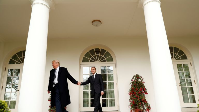 U.S. President Donald Trump (L) and French President Emmanuel Macron walk down the colonnade at the White House following the official arrival ceremony for Macron on the South Lawn of the White House in Washington, U.S., April 24, 2018. REUTERS/Kevin Lamarque
