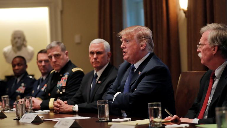 U.S. President Donald Trump receives a briefing from senior military leadership accompanied by Vice President
