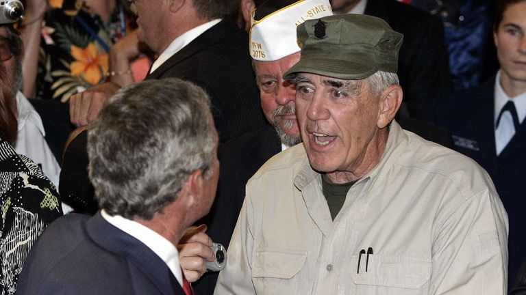 The US actor and Marine Corps veteran shakes hands with then president George W Bush in 2005