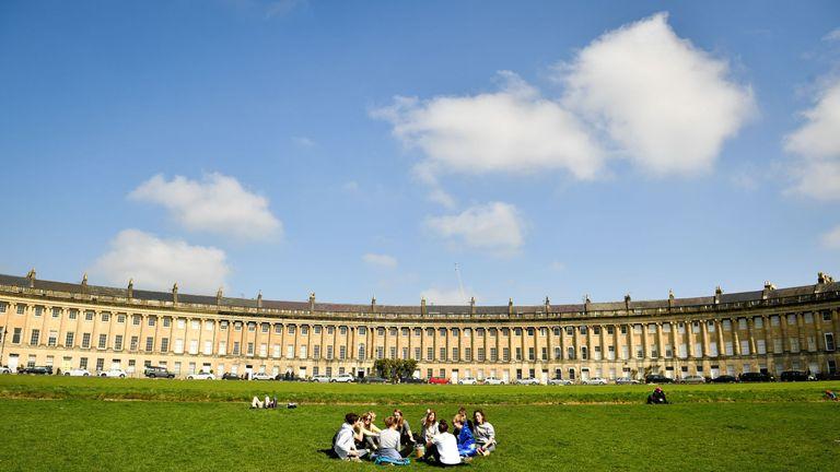 Friends enjoy a picnic in the sunshine in Bath on Saturday