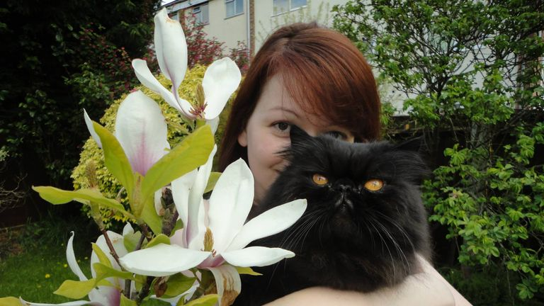 Ms Skripal pictured with one of her father's two cats - one has died and the other is missing. Pic: Facebook