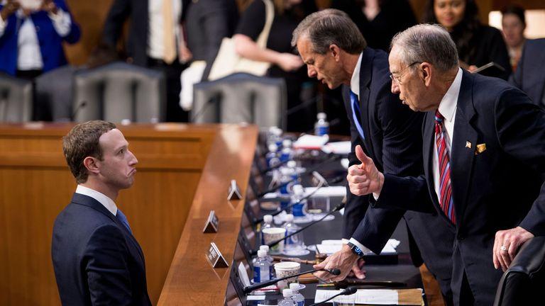 Mark Zuckerberg (L) speaks with Senator John Thune (C), R-SD, and Senator Chuck Grassley (R)