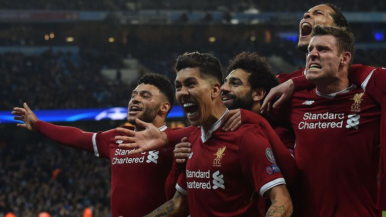 Liverpool players celebrate their goal against Manchester City in the Champions League quarter-final