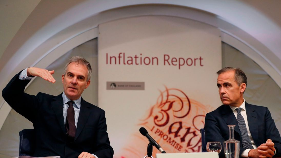 Bank of England Governor Mark Carney (R) listens as Deputy Governor for Monetary Policy Ben Broadbent speaks during the central Bank's quarterly Inflation Report press conference at the Bank of England.