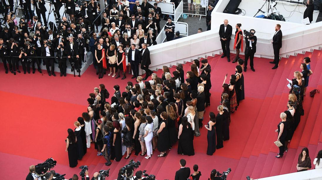 Filmmakers, actresses and producers listen to Australian actress and President of the Jury Cate Blanchett read a statement on the red carpet in protest of the lack of female filmmakers honored throughout the history of the festival at the screening of 'Girls Of The Sun (Les Filles Du Soleil)' during the 71st annual Cannes Film Festival at the Palais des Festivals on May 12, 2018 in Cannes, southeastern France. - Only 82 films in competition in the official selection have been directed by women s