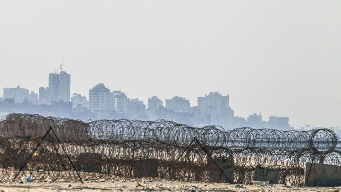 The skyline of Gaza City from the beach in the Israeli kibbutz of Zikim