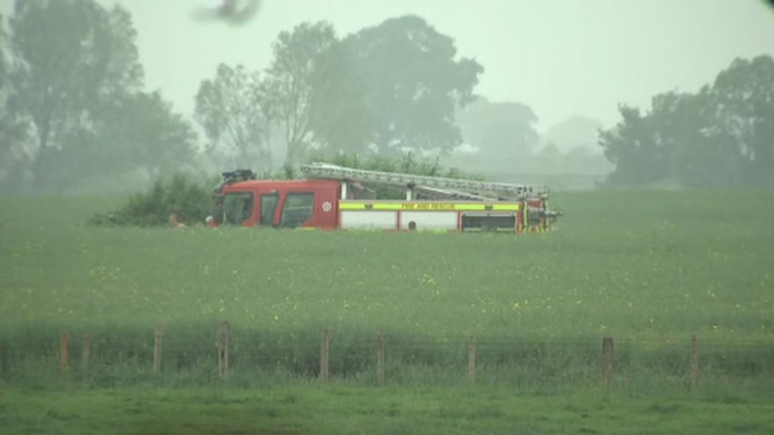 Firefighters attend a helicopter crash in Aldborough, North Yorkshire