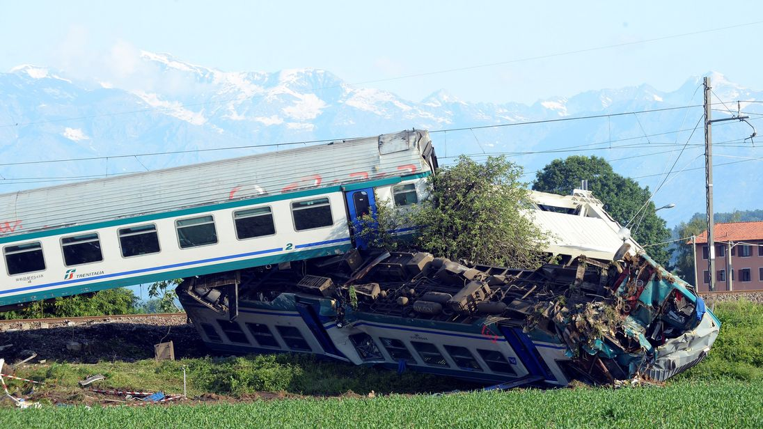 2 dead, several injured as train hits truck, derails in Italy