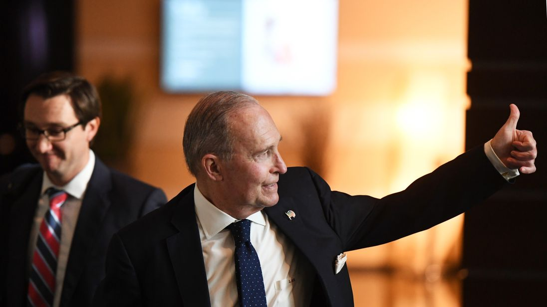 White House economic adviser Larry Kudlow gives a thumbs-up in Beijing