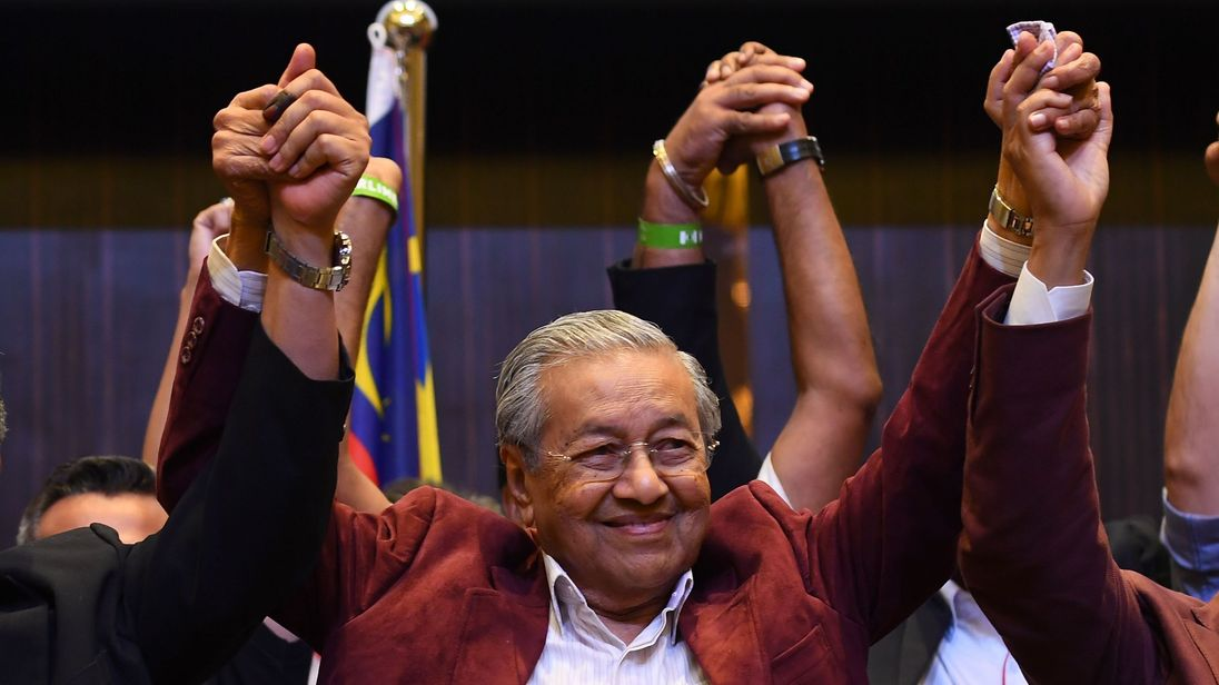 Malaysia's former PM and wife barred from leaving country